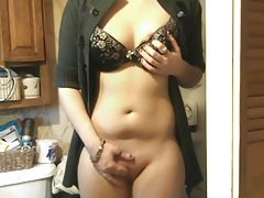Girl in cardigan plays with her pussy tubes
