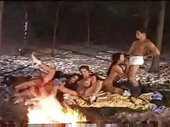 Group sex by the fire in the snow tubes