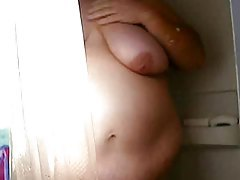Fat amateur films her shower tubes