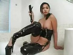 Femdom in latex talks to you about jerking off tubes