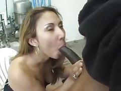She sits outdoors and sucks a dark dick tubes