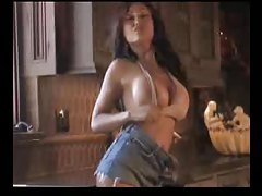 Busty babe dance and strip in kitchen tubes