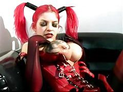 Redhead in crazy fetish outfit rubs body tubes