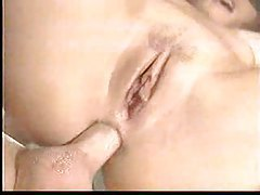 Fingering her pussy as her ass is pounded tubes
