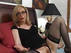 Blonde in stockings and glasses eating cock tubes