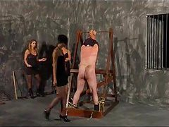 Three mistresses beat the male slave tubes