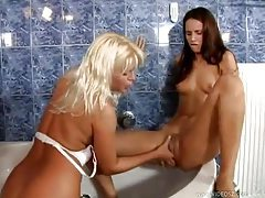 Skinny lesbian chicks have fun sex in tub tubes