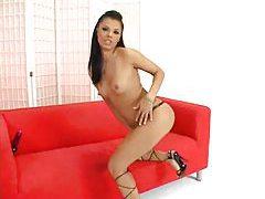 Slender girl in a skirt strips to lingerie tubes