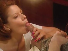 Busty redhead in a short skirt foreplay tubes