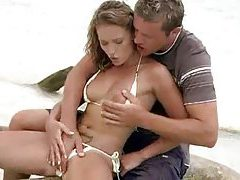 Foreplay on a beach with bikini hottie tubes