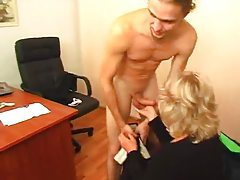 Mature secretary seduces him in the office tubes