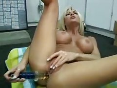 Bimbo blonde gives her ass a good toy fucking tubes