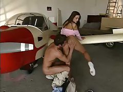 Airplane hangar scene with girl on big cock tubes