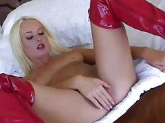 Melissa Black masturbates in latex boots tubes