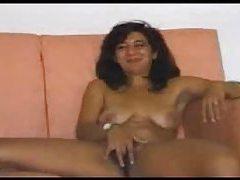 Mature gal gets naked and masturbates tubes
