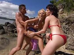 Sunny threesome on the beach and in the ocean tubes