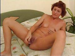Brunette milf with long toy for her vagina tubes