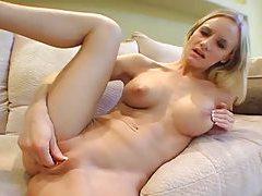 Skinny blonde takes off bikini top and fingers tubes