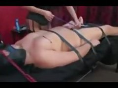 Bound gal makes her bound man suffer tubes