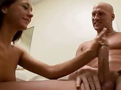 Skinny girl strokes a big cock in the bathroom tube