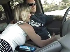 Wife jacks him off in the car tubes