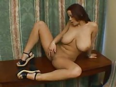 Busty girl in a hotel room plays with her cunt tubes