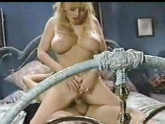 The tease video ends with cum on her retro tits tubes