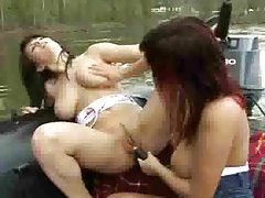 Girls in a motorboat have fun fooling around tubes