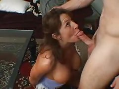 Milf drops to her knees to blow sporty guy tubes