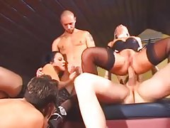 Hot lesbians in stockings fool around and fuck in group tubes