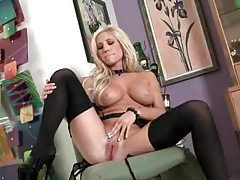 Big tits blonde in stockings is erotically charged tubes