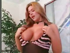 Sheer black lingerie on this big tits redhead tubes