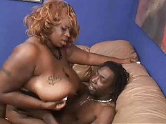 Stuffing a fat black bitch in her tight cunt tubes