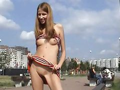 Hot skinny teen shows her small tits and pussy in public tubes