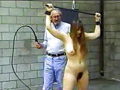 Old man whips a girl in bondage tubes