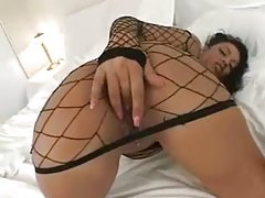 Latina teases in her sexy fishnet dress tubes