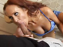 Redhead milf in a tight dress sucks his cock tubes