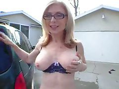 Nina Hartley washes the car in her lingerie tubes