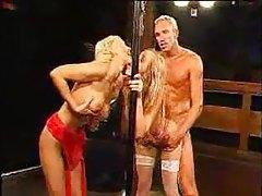 Hot blonde on her knees for huge bukkake tubes