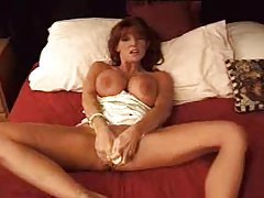 Milf redhead in white satin lingerie toys cunt tubes