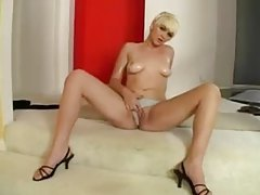 Short hair natural blonde teases in her skirt tubes