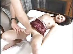 A couple of guys play with the hairy Asian hottie tubes