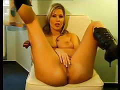 Big tits chick in sexy boots plays with cunt tubes