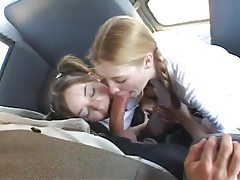 Pigtailed schoolgirls suck dick on the bus tubes