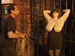 Fat girl in bondage has her tits whipped tubes