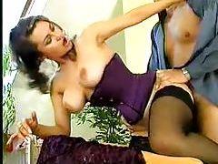 Retro pornstar in a tight purple corset fucked tubes