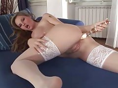 An erotic glass dildo fuck with a babe in stockings tubes