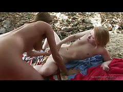Lesbian lovers on the beach get off tubes