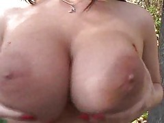 Jiggling her big naked tits outdoors tubes