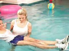 Sexy girls have clothed fun in the pool tubes